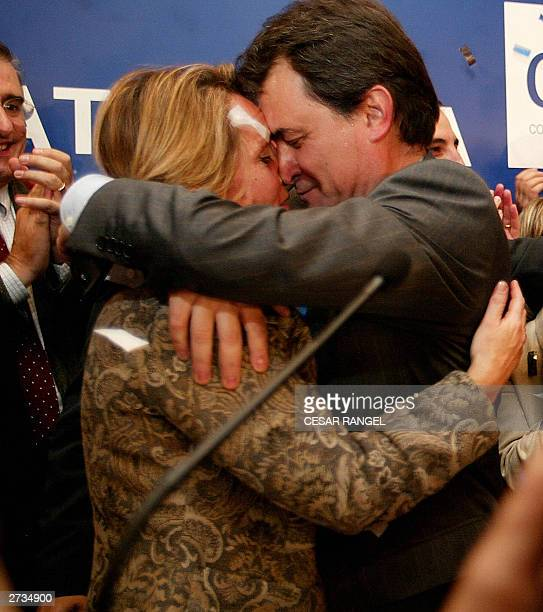 Catalan Nationalist Party candidate Artur Mas is congratulated by his wife after winning the Catalan presidency in the Spanish autonomic elections in...