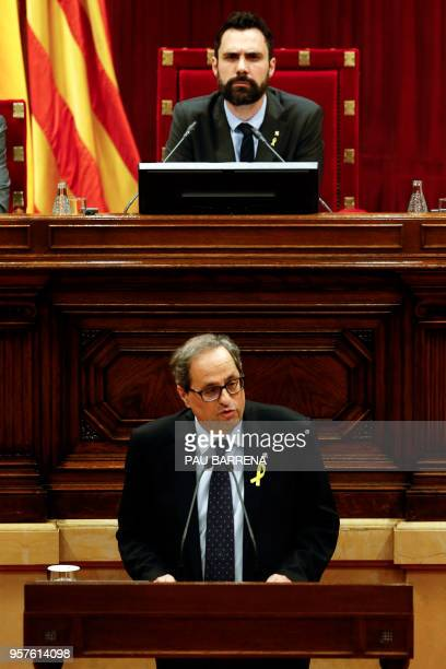 Catalan Parliament Speaker Roger Torrent listens to a speech by Junts per Catalonia MP and presidential candidate Quim Torra during a session at the...