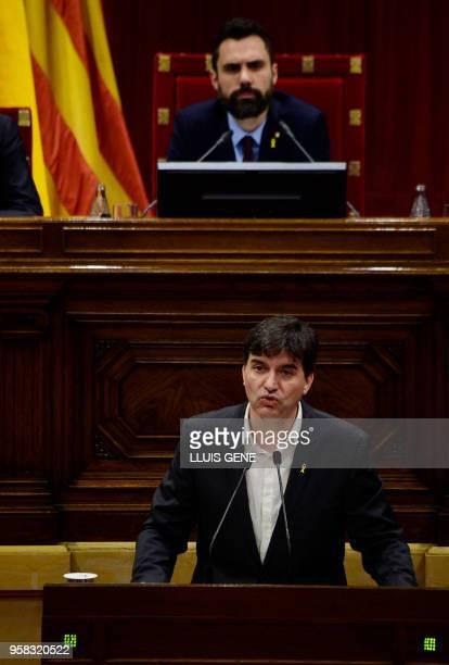 Catalan Parliament Speaker Roger Torrent listens to a speech by MP Sergi Sabria of 'Esquerra Republicana de Catalunya' during a vote session to elect...