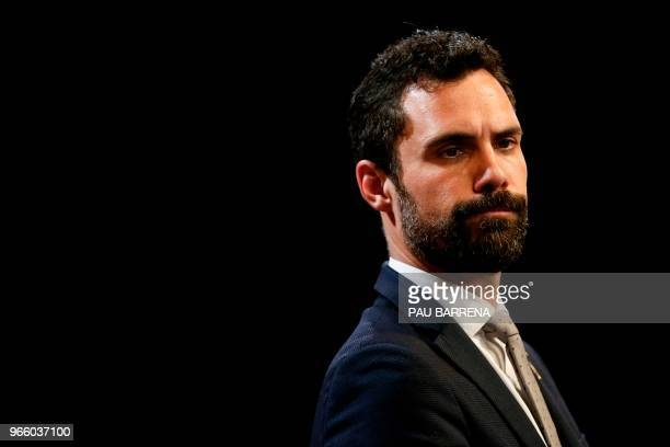 Catalan Parliament Speaker Roger Torrent reacts while addressing an official swearingin ceremony for the new government at the Generalitat Palace in...