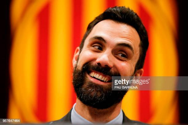 Catalan Parliament Speaker Roger Torrent smiles during a session at the Catalan parliament in Barcelona on May 12 2018 Catalonia's parliament will...