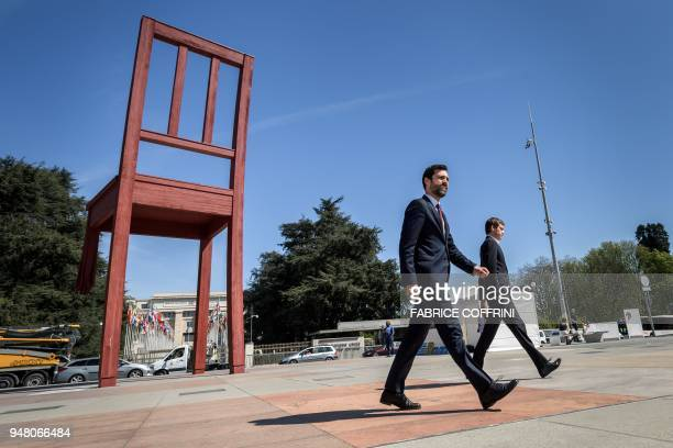 TOPSHOT Catalan Parliament speaker Roger Torrent walks past the 'Broken Chair' as he arrives to deliver a statement during his visit in Switzerland...