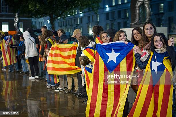 CONTENT] Catalan people are holding proindependence flags while doing a human chain the Catalan way During the National Day of Catalonia a...