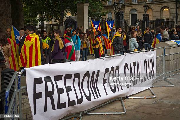 CONTENT] Catalan people celebrating the National Day of Catalonia in Downing Street London There is a banner claiming for freedom for Catalonia...