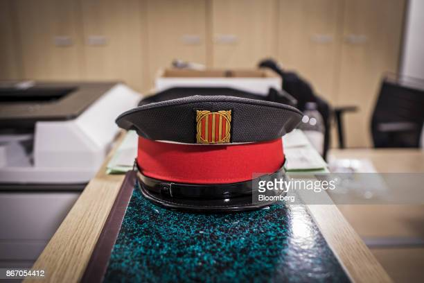 A Catalan police badge sits on the hat of a Mossos d'Esquadra police officer at the Urban Transportation Service office at the Barcelona Sants...