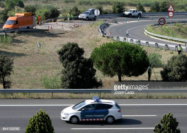 Catalan police investigate the scene of a bus accident in San Pol de Mar near to Barcelona on July 31 2009 At least six people died and dozens were...