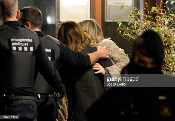 Catalan police officers free a woman who had been taken hostage by a Malian man in that country's consulate in Barcelona on March 19 2018 A man from...