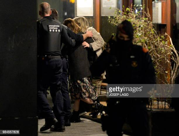 Catalan police officers free the wife of Mali's honorary consul who had been taken hostage by a Malian man in that country's consulate in Barcelona...