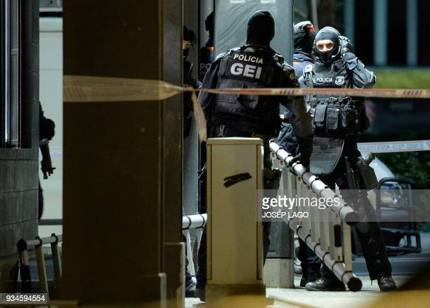 Catalan police officers prepare to intervene at the consulate of Mali where a Malian man allegedly has taken a woman hostage in Barcelona on March 19...