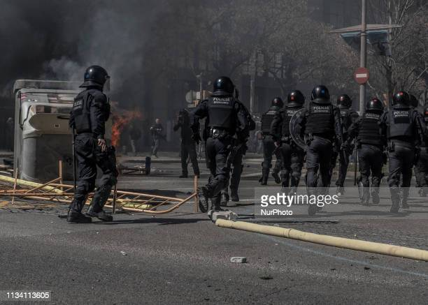 Catalan police running through the street during a Vox party rally in Barcelona Spain on Saturday March 30 2019