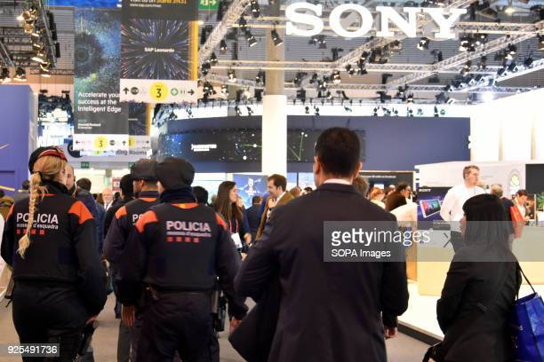Catalan police seen walking past the SONY stand at the Mobile World Congress The Mobile World Congress 2018 is being hosted in Barcelona from 26...