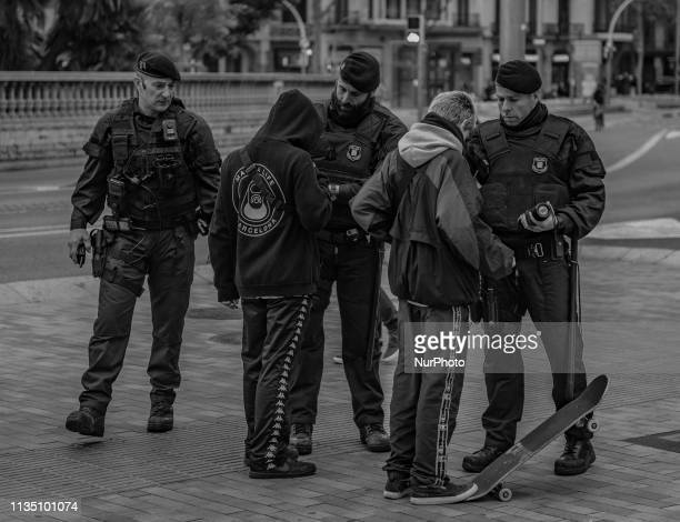 Catalan policemen control people in Barcelona Spain on April 5 2019