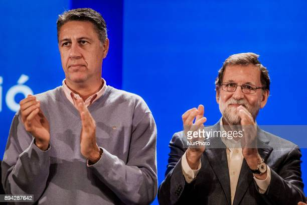 Catalan Popular Party leader and candidate for the upcoming Catalan regional election Xavier Garcia Albiol and Spanish Prime Minister Mariano Rajoy...