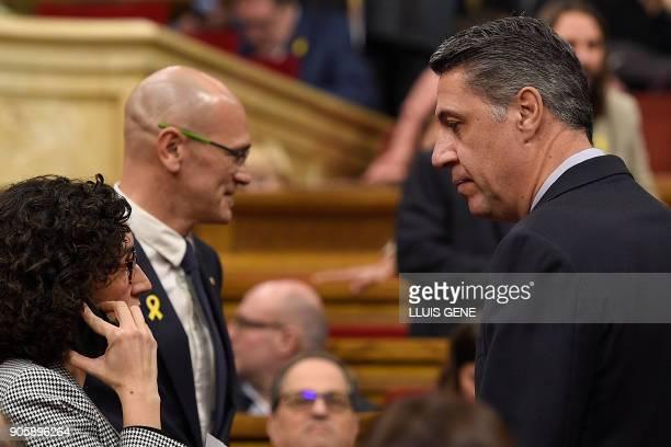 Catalan Popular Party PPC leader Xavier Garcia Albiol talks with 'Esquerra Republicana de Catalunya' ERC leader Marta Rovira next to ERC member Raul...