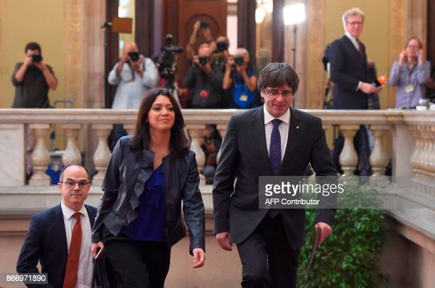 Catalan president Carles Puigdemont and his wife Marcela Topor arrive at the Catalan parliament in Barcelona on October 27 2017 The Catalan...