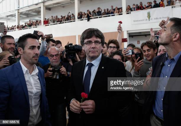 Catalan President Carles Puigdemont arrives to inspect a sport hall as police and gendarmerie crew intervene the voters in the Catalan independence...