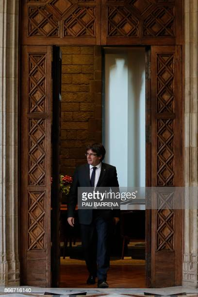 Catalan president Carles Puigdemont arrives to make an institutional statement at the 'Generalitat' in Barcelona on October 26 2017 Catalan leader...
