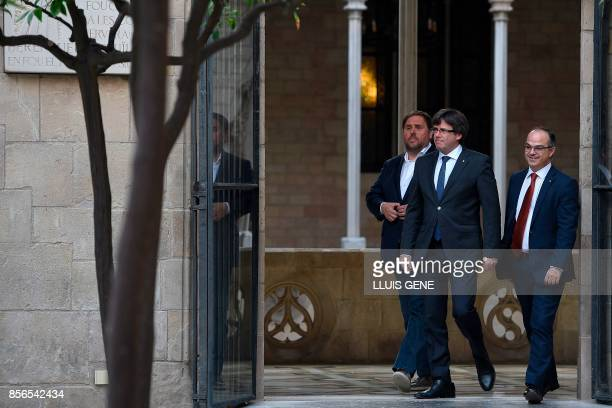 Catalan president Carles Puigdemont arrives with Catalan government spokesman, Jordi Turull and leader of the left-wing party Esquerra Republicana ,...