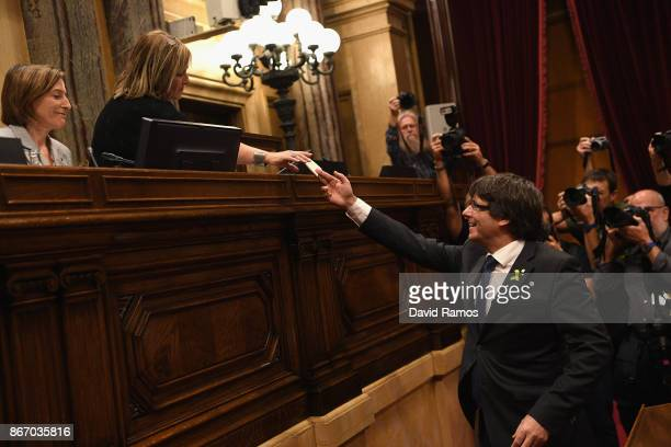 Catalan President Carles Puigdemont casts his vote for independence from Spain at the Catalan Government building Generalitat de Catalunya on October...