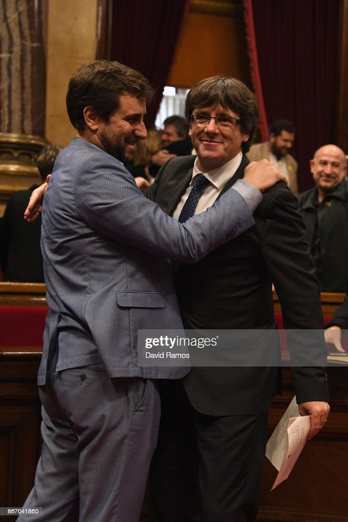 Catalan President Carles Puigdemont (R) is hugged by Minister of Health Antoni Comín as they react to the news that the Catalan Parliament has voted in favour of independence from Spain at the Catalan Government building Generalitat de Catalunya on October 27, 2017 in Barcelona, Spain. MPs in the Catalan parliament have today voted following a two day session on how to respond the Spanish government's enacting of Article 155, which would curtail Catalan autonomy.