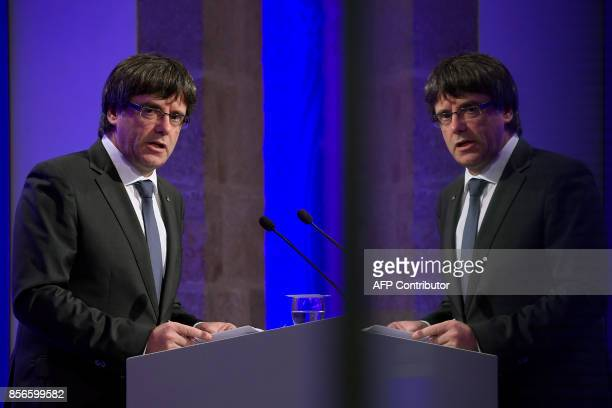 Catalan president Carles Puigdemont is reflected on a window as he gives a press conference in Barcelona on October 2 2017 Catalonia's leader Carles...