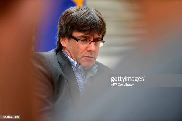 Catalan president Carles Puigdemont looks on during an AFP interview in Girona on September 30 2017 The mission was entrusted to him almost by...