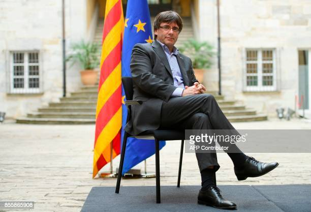 Catalan president Carles Puigdemont poses before an AFP interview in Girona on September 30 2017 The mission was entrusted to him almost by accident...