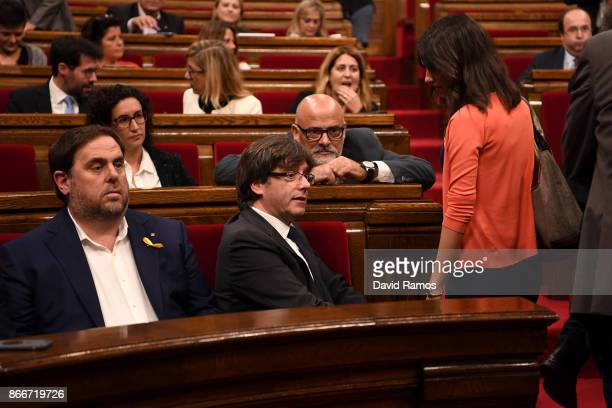 Catalan President Carles Puigdemont speaks with Ines Arrimadas spokeperson of Ciudadanos party before a meeting of the Catalan government at the...
