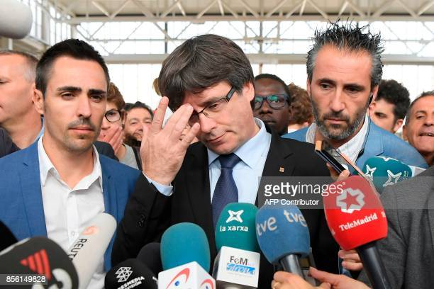 Catalan president Carles Puigdemont talks to the media in Sant Julia de Ramis on October 01 during a referendum on independence for Catalonia banned...