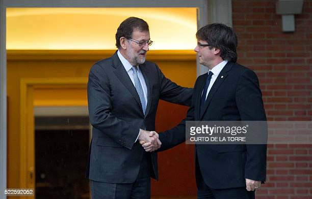 Catalan Prime Minister Carles Puigdemont shakes hands with Spanish caretaker Prime Minister Mariano Rajoy before their meeting at La Moncloa palace...