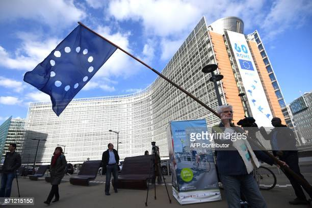 A Catalan proindependence demonstrator holds an European flag with cut out stars during a demonstration of proindepence Catalan mayors to show...