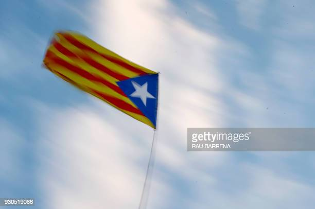 A Catalan proindependence 'Estelada' flag flies during a protest to demand a Catalan republic called by the proindependence Catalan National Assembly...
