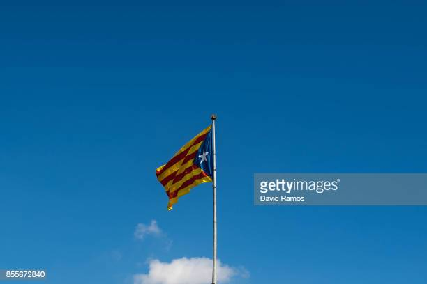 Catalan ProIndependence flag 'Estelada' waves on the summit of a hill on September 29 2017 in Tona Spain The Catalan government is keeping with its...