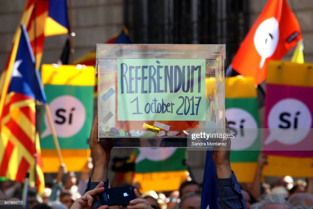 Catalan referendum supporters hold a replica of a ballot box up during a demonstration of Catalan Mayors backing Independence Referendum on September 16, 2017 in Barcelona, Spain. 712 Catalan mayors who have backed the independence referendum were summoned by Spain's State Prosecutor over the independence vote, threatening arrests over non-cooperation. The vote on breaking away from Spain was called by the Catalan government for October 1, 2017 but was suspended by the Spanish Constitutional Court following a demand from the Spanish Government. Catalan and Spanish security forces have been instructed by Spain's Public Prosecutor's Office to take all the elements which could promote or help to celebrate the referendum. This includes ballots, ballots boxes and promotional material.