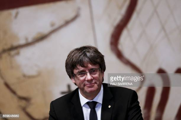 Catalan regional government president Carles Puigdemont attends a regional government meeting at the Generalitat Palace in Barcelona on October 10...