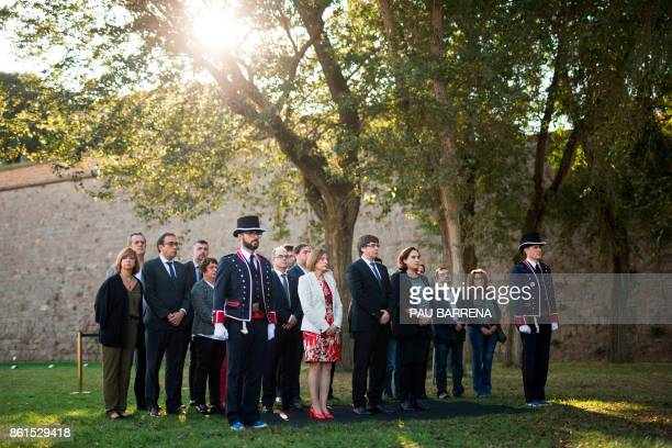 Catalan regional government president Carles Puigdemont Catalan parliament president Carme Forcadell and Barcelona mayor Ada Colau pay their respects...