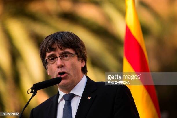 Catalan regional government president Carles Puigdemont delivers a speech on the sidelines of a wreathlaying ceremony commemorating the 77th...