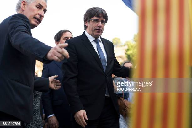 Catalan regional government president Carles Puigdemont prepares to lay a wreath at a monument honouring civil war victims on the sidelines of a...