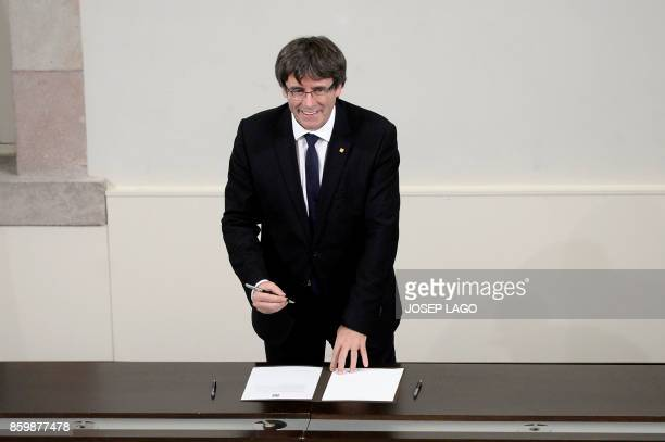 Catalan regional government president Carles Puigdemont signs a document about the independence of Catalonia at the Catalan regional parliament in...