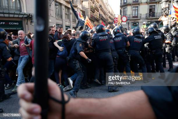 Catalan regional police 'Mossos D'Esquadra' clash with separatist protesters during a counter-protest against a demonstration in support of Spanish...