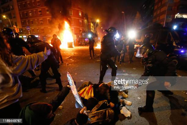 TOPSHOT Catalan regional police 'Mossos D'Esquadra' officers clash with demonstrators during a protest called by Catalan separatist movement...
