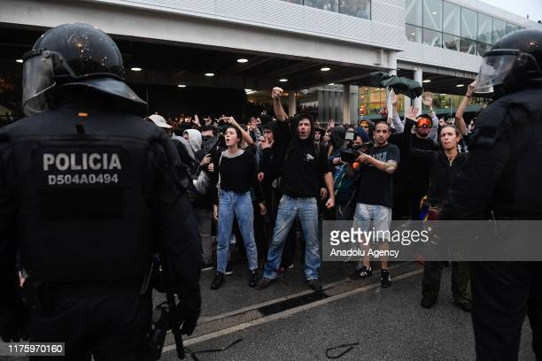Catalan regional police 'Mossos D'Esquadra' officers intervene in protesters at El Prat Airport during a demonstration in Barcelona Spain on October...