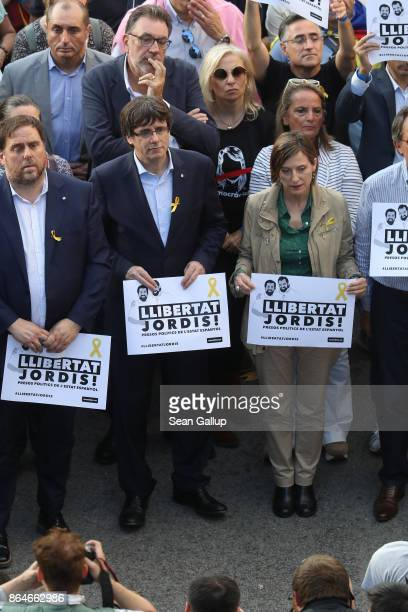 Catalan regional President Carles Puigdemont and Catalan Parliament President Carme Forcadell attend a Catalan independence rally to demand the...
