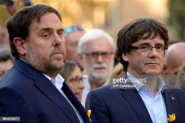 Catalan regional president Carles Puigdemont and Catalan regional vicepresident and chief of Economy and Finance Oriol Junqueras attend a...