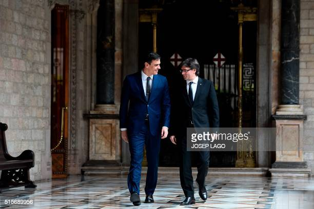 Catalan regional president Carles Puigdemont and Spanish Socialist Party leader Pedro Sanchez walk to a meeting at the Generalitat palace in...