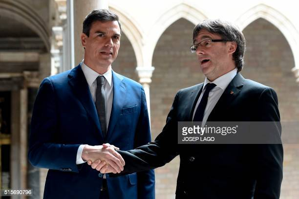 Catalan regional president Carles Puigdemont and Spanish Socialist Party leader Pedro Sanchez shake hands before a meeting at the Generalitat palace...