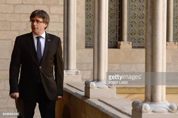 Catalan regional president Carles Puigdemont arrives to give a speech in Barcelona on September 20 2017 Spanish police detained 13 Catalan government...