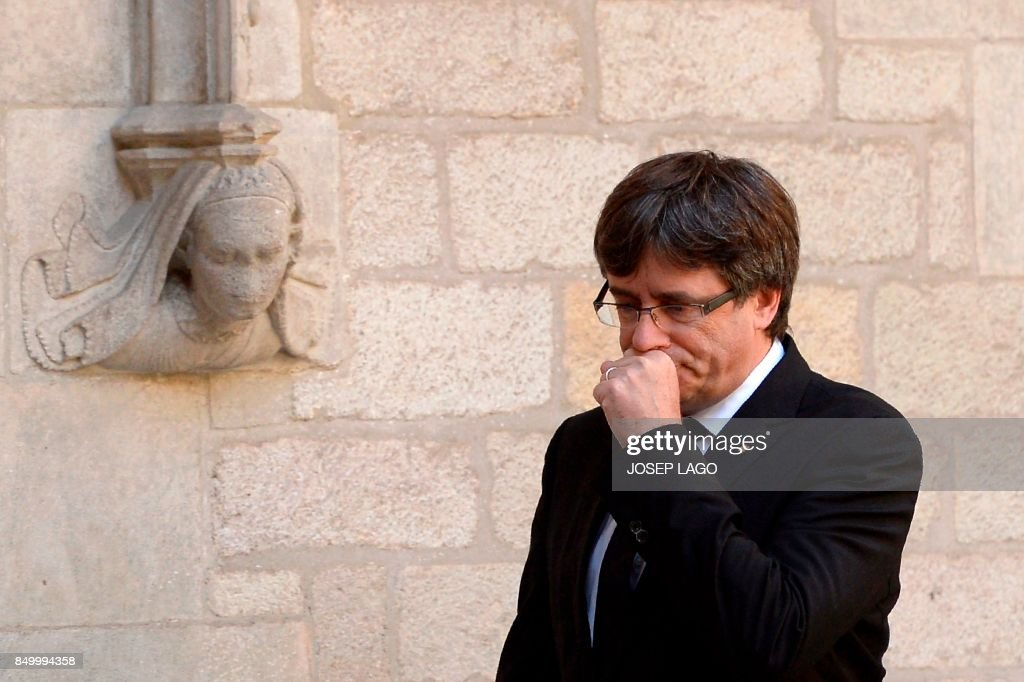 Catalan regional president Carles Puigdemont arrives to give a speech in Barcelona on September 20, 2017. Spanish police detained 13 Catalan government officials as they continued to crack down on preparations for an independence referendum in the region which Madrid says is illegal, sparking angry protests in Barcelona. The operation comes amid mounting tensions as Catalan leaders press ahead with preparations for an independence referendum on October 1 despite Madrid's ban and a court ruling deeming it unconstitutional. PHOTO / Josep LAGO