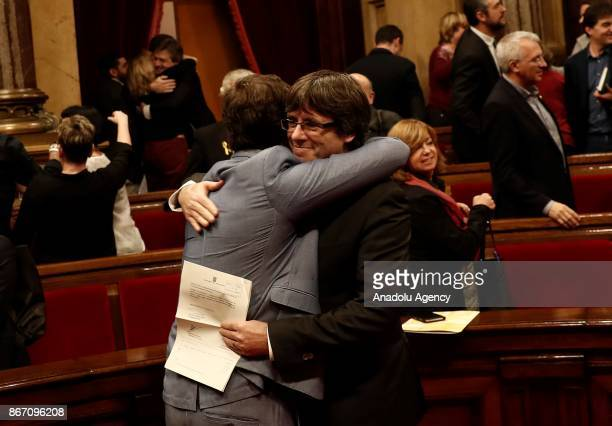 Catalan regional President Carles Puigdemont celebrates after Catalonian Parliament declared independence following the secret ballot at Catalonian...