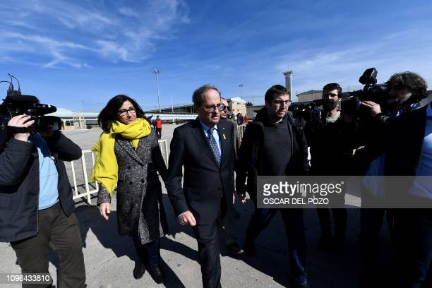 Catalan regional president Quim Torra leaves with members of his communication team Pere Cardus and Anna Figuera after visiting jailed Catalan...